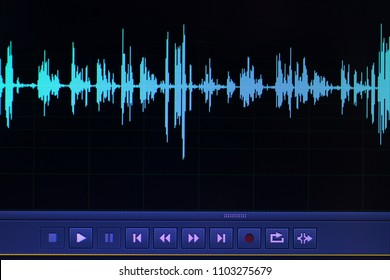 Audio sound wave studio editing computer program screen showings sounds on screen from vocal recording of voiceover.