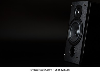 Audio speaker system on a black background. Minimalistic concept