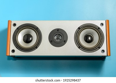 Audio speakers on blue background. The musical equipment. Close-up