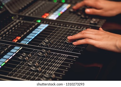 Audio system for professionals. Close-up view of sound engineer adjusting digital audio mixing console. Sound recording studio. Media production studio. Music record service