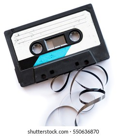 audio tape blank label rolled out isolated white audiotape