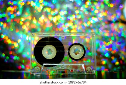 Audio tapes for tape recorder 70s 80s 90s bokeh vintage fashion old retro wallpaper background texture closeup nostalgia music sound style trend party dance disco