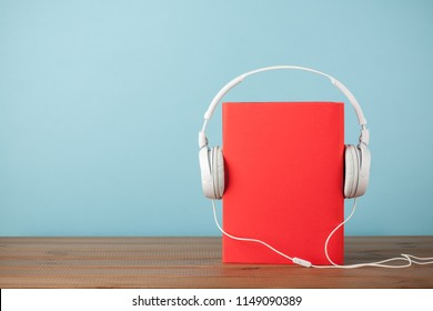 Audiobook concept with book and headphones