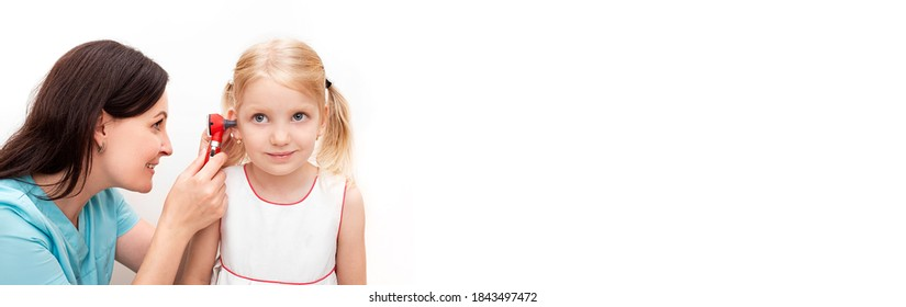 Audiologist performs a hearing test to a little girl patient using an otoscope over white background, side view web banner