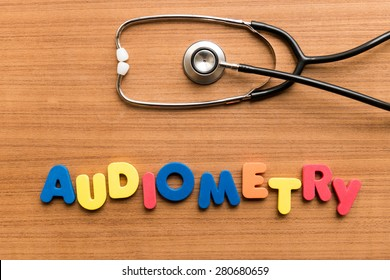 Audiometry   colorful word with Stethoscope on wooden background