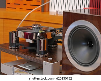 Audiophile HiFi turntable player with musical vinyl record and speakers.