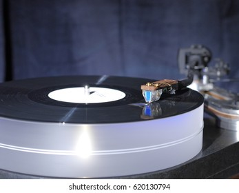 Audiophile HiFi turntable player with musical vinyl record.
