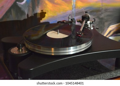 Audiophile turntable with vinyl record.