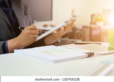 Audit checklist on document board, business working with paper.