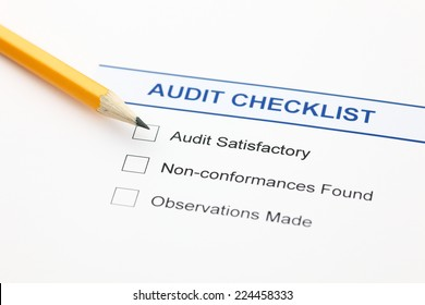 Audit checklist and pencil.