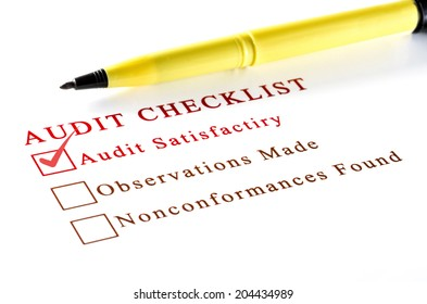 Audit checklist, with tick against on white paper