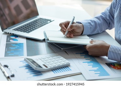 Audit concept,Administrator business man financial inspector and secretary making report calculating balance. Internal Revenue Service checking document.
