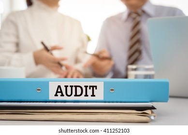 The audit file of financial statements with the auditor are providing advice to manager. Accounting auditing concept.