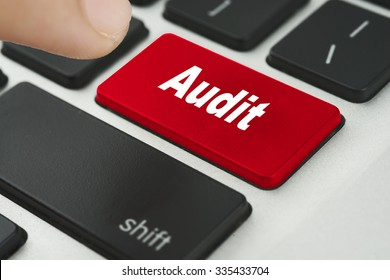 Audit red keyboard button with female hand try to enter it - financial, business, online and data concept