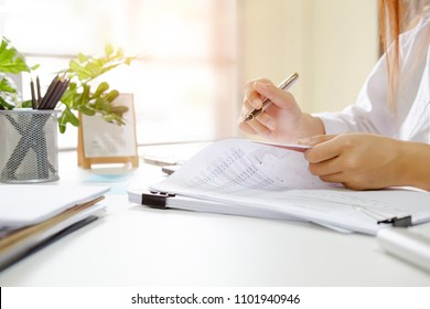 Audit woman check document data financial in paper.