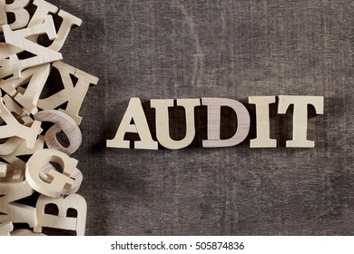 AUDIT word made with wooden letters