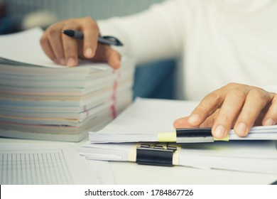 Auditor businesswoman checking unfinished document legal prepare paperwork or report for analysis information in TAX time, accountant in workload data contract partner deal in workplace at office