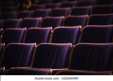 auditorium with seats, chairs in auditorium colored by spotlights