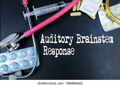 Auditory Brainstem Response word, medical term word with medical concepts in blackboard and medical equipment background.