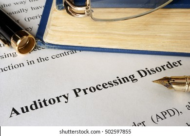Auditory processing disorder APD on a sheet on an office table.