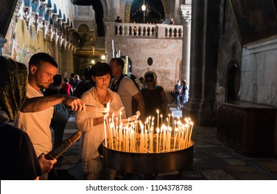 Aug 10, 2017 - People light candles in the Church of the Holy Sepulchre Jerusalem