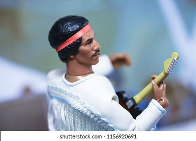 AUG 14 2018: Recreation of a scene from 1969 Woodstock Music Festival with guitarist Jimi Hendrix and Band of Gypsys - using a Mego Target exclusive action figure