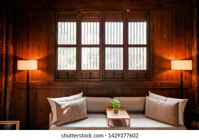 AUG 18, 2011Hangzhou, China : Contemporary Chinese style living room interior decoration in old Chinese wooden house with warm light, beige colour sofs couch and lamp