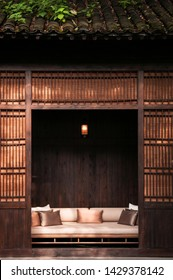 AUG 18, 2011Hangzhou, China : Contemporary Chinese style sofa couch behind old wooden sliding doors in ancient Chinese house