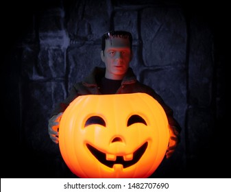 AUG 18 2019: Frankenstein monster holding a glowing jackolantern pumpkin - custom Mego Corporation action figure