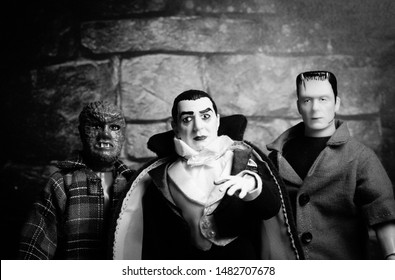 AUG 18 2019: Halloween concept of Frankenstein, Count Dracula and Werewolf - vintage retro movie poster look - Mego Corporation action figures