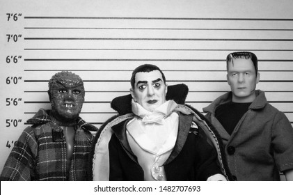 AUG 18 2019: Halloween concept of Frankenstein, Count Dracula and Werewolf - vintage retro movie mugshot - Mego Corporation action figures