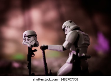 AUG 18 2019: Star Wars concept of Imperial Stormtrooper mourning loss of a fallen comrade - Hasbro action figure