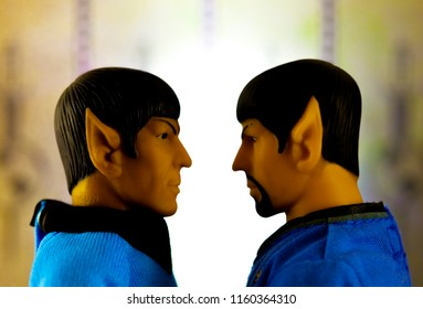 AUG 19 2018: Concept scene from Star Trek Original Series episode Mirror Mirror with Good and Evil Spock staring eye to eye - using Mego action figures