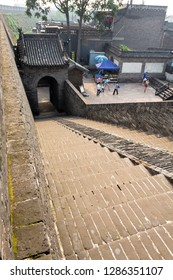 Aug 2013 - Pingyao, China - Entry staircase of the ancient walls protecting the Old city of Pingyao. Pingyao is a UNESCO World Heritage Site