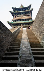 Aug 2013 - Pingyao, China - Tourists on the entry staircase of the ancient walls protecting the Old city of Pingyao. Pingyao is a UNESCO World Heritage Site