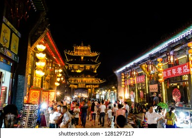 Aug 2013 - Pingyao, Shanxi, China - Pingyao South Street, one of the main of the Old town, crowded with tourists at night. Pingyao is a UNESCO world Heritage site