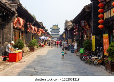 Aug 2013 - Pingyao, Shanxi, China - Tourists and locals in the South Street of Pingyao, one of the main roads of the old city. Pingyao is a UNESCO world Heritage site