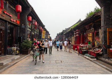 Aug 2013 - Pingyao, Shanxi, China - the streets of Pingyao Ancient city at sunset crowded with tourists. Known as one of the best preserved villages of China, Pingyao is a UNESCO world Heritage site