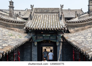 Aug 2013 - Pingyao, Shanxi province, China - Tiled roofs door in one of the courtyards of Ri Sheng Chang, the oldest bank in the world in Pingyao Ancient City, UNESCO World Heritage Site
