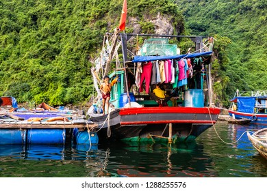 Aug 2016 - Halong Bay, Vietnam – Fishermen boats in Halong Bay. Set in the gulf of Tonkin, Halong Bay is a UNESCO World Heritage Site, famous for its karst formations.