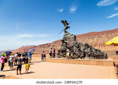 "Aug 2017, Flaming Mountains, Xinjiang, China: tourists near a statue from a scene of the Chinese epic ""Journey to the west"" when the monkey king and his companions reach the flaming mountains"