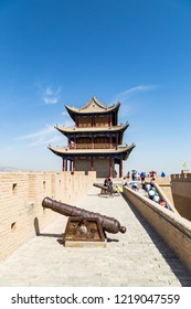"""Aug 2017 - Jiayuguan Fort, Gansu, China - Cannon and watchtower of Jiayuguan Fort, China. Known as """"first pass under the heaven"""", it was the most western fort of ancient china on the silk road"""