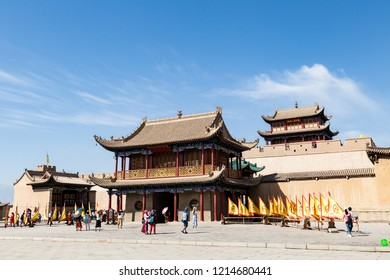 """Aug 2017 - Jiayuguan, Gansu, China - Tourists in front of the entry gate of Jiayuguan Fort. Known as """"first pass under the heaven"""", it was the most western fort of ancient china on the silk road."""