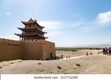 "Aug 2017 - Jiayuguan, Gansu, China - Tourists outside of the gate facing the Gobi desert. Known as ""first pass under the heaven"", Jiayu Pass was the most western fort of ancient china on the silk road"