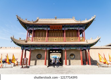"""Aug 2017 - Jiayuguan, Gansu, China - Moon above the entry gate of Jiayuguan Fort. Known as """"first pass under the heaven"""", it was the most western fort of ancient china on the silk road."""