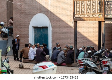 Aug 2017, Kashgar, Xinjinag, China: local Uighur people in the streets of Kashgar Ancient Town. Kashgar is a popular tourist place along the Silk Road and one of the westernmost cities of China