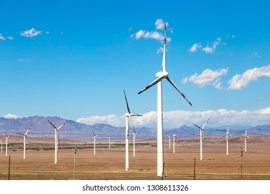 Aug 2017 – Xinjiang, China – The deserts of Xinjiang, the westernmost province of China, are full of Wind Turbine Power Plants. Here a Wind farm along the highway from Turpan to Urumqi
