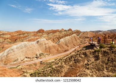 Aug 2017 - Zhangye, China - tourists watching from the observation deck of the Sea of Clouds, an area in Danxia Feng, or Colored Rainbow Mountains, in Zhangye, Gansu province, China.