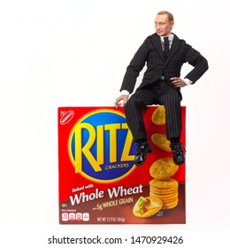 "AUG 3 2019: Caricature of Russian president Vladimir Putin atop a box of Ritz crackers illustrating the joke ""Putin on the Ritz"""