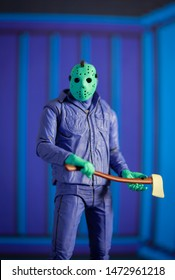 AUG 6 2019: recreation of a scene from the Nintendo NES 8-Bit Friday the 13th video game showing Jason Voorhees in day glow colors - Neca GameStop exclusive action figure